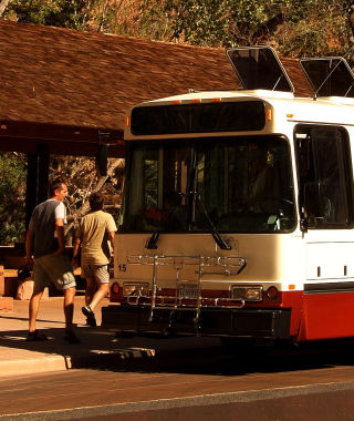 Zion shuttle picking up guests
