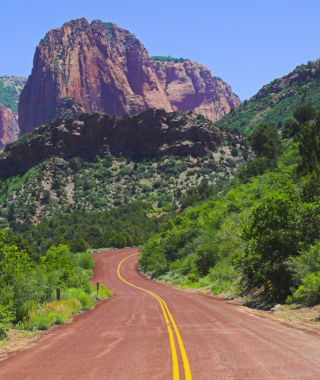 Red road to the mountains of the Zion National park